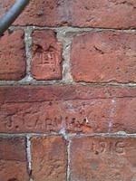 WJ Carvill - brick carving